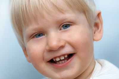 A little boy happy after his visit with the dentist.